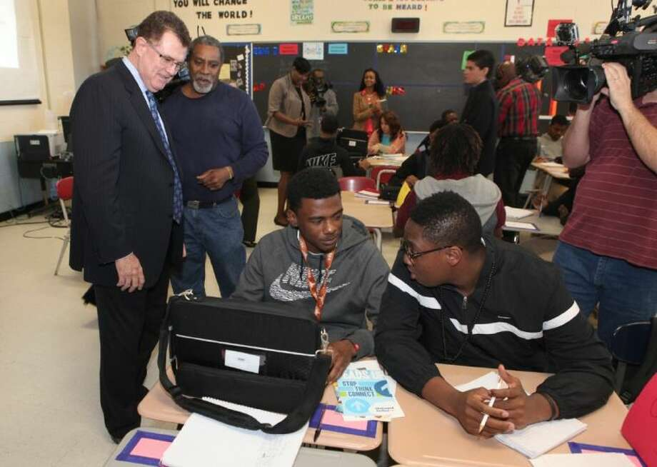 Houston ISD Superintendent Terry Grier watches students at Madison High School with their new laptops. The district's Power Up initiative is distributing nearly 19,000 laptops to students at 11 high schools. All high schools will be participating in the initiative in the coming two years. Photo: Photo By Alan Warren