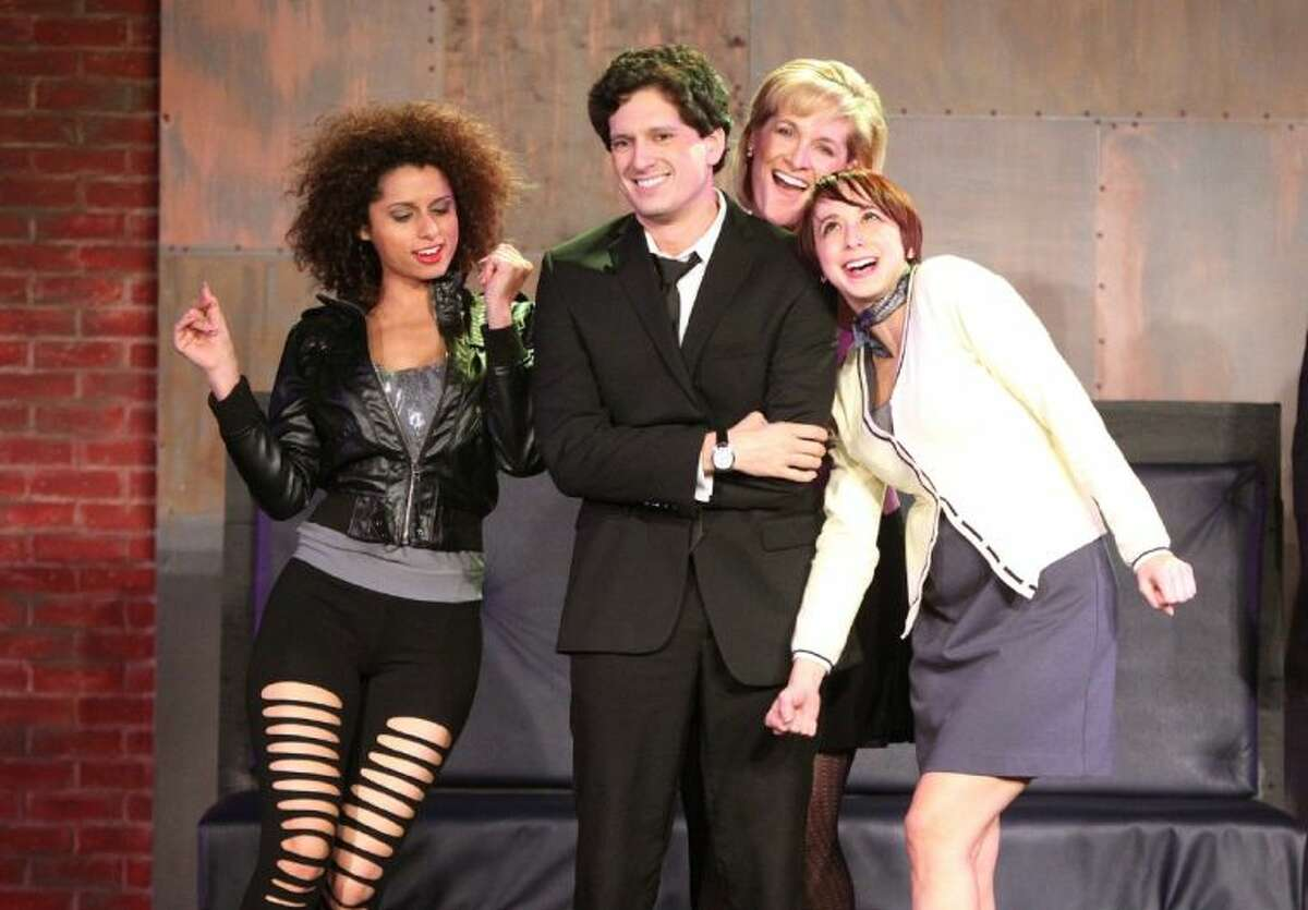 Louis Crespo Jr. playing Bobby surrounded by the girlfriends, Courtney Locke as Marta, Karen Lasater as Kathy , and Carly Drake as April in the production of Stephen Sondheim's Company at KVPAC in Katy.