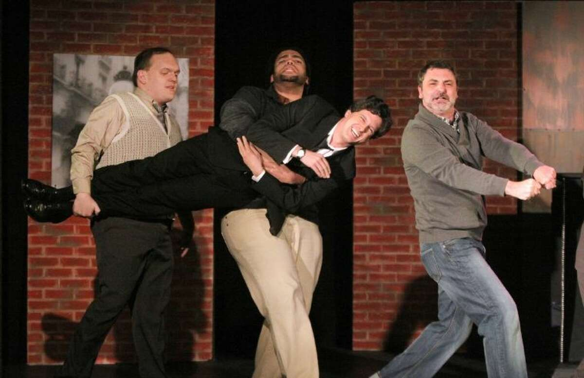 Louis Crespo Jr. playing Bobby is carried by Alex Cochrane as Peter, Joseph Allen Holloway as David and Gregory Magyar as Harry in the production of Stephen Sondheim's Company at KVPAC in Katy.