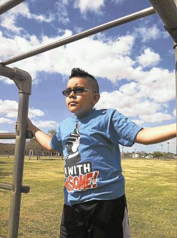 Christopher Astudillo enjoys a day at Bear Creek park. Christopher is fighting for his life after being diagnosed with leukemia. / @WireImgId=2658618