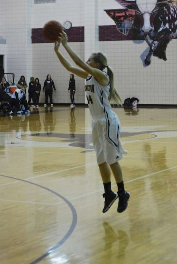 Ashley Lambert (34) fires off a three-pointer in the third period of the Feb. 4 game against Liberty.