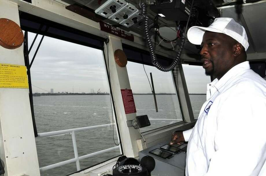 Capt. Johnny Smith works his shift on the Galveston Island Ferry. Smith has been working on the ferry since 1989 and started as a deckhand before working his way up to able-bodied seaman, mate, and then captain. Photo credit: Jeannie Peng-Armao, San Jacinto College marketing, public relations, and government affairs department.