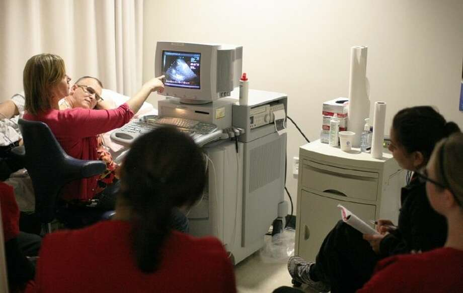 ACC Pediatric Echocardiography instructor Sue Poston, far left, shows her students some of the details on the echocardiograph screen during a recent class. Photo: Courtesy ACC