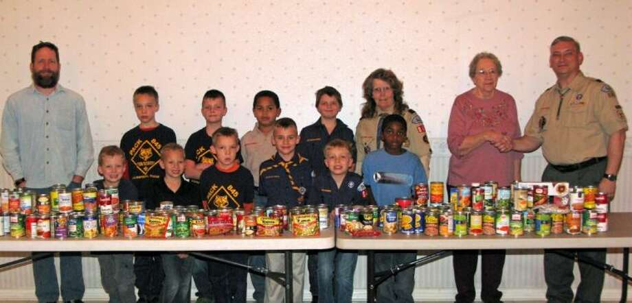 Cub Scouts with Pack 845 present 250 lbs. of canned foods to Esther Best for Care/Share Mission of San Jacinto County. Photo: Submitted Photo