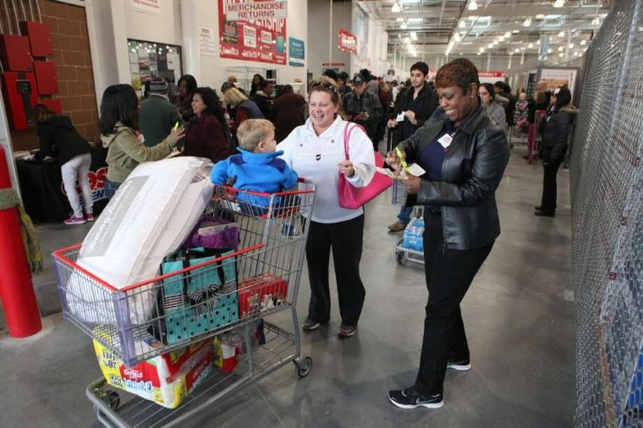 costcos titantia baker checks receipts at the door at the new costco in katy on opening
