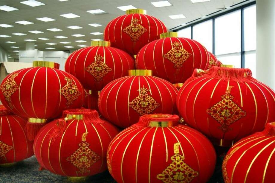 Some of the authentic red lanterns that were presented to Fort Bend County by representatives of Chancheng District, of Foshan City, China. The lanterns will hang in the lobby of the University Branch Library for the Chinese Lantern Festival this Saturday. Photo: Courtesy FBCL