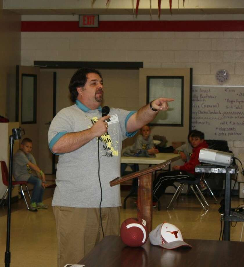 """John """"Brad"""" Crow teaches the students about how his one big mistake cost him his future in football. Photo: JACOB MCADAMS"""