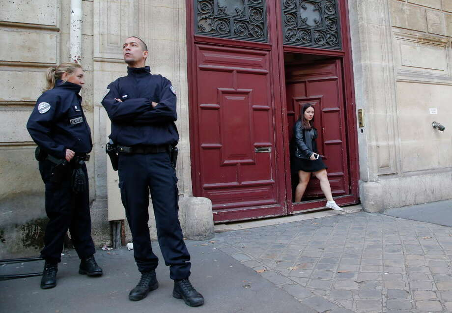 French police officers stand outside the residence of Kim Kardashian West in Paris Monday, Oct. 3, 2016. Kim Kardashian West was unharmed after being robbed at gunpoint of more than $10 million worth of jewelry inside a private Paris residence Sunday night, police officials said. (AP Photo/Michel Euler)  Photo: Michel Euler / Copyright 2016 The Associated Press. All rights reserved.