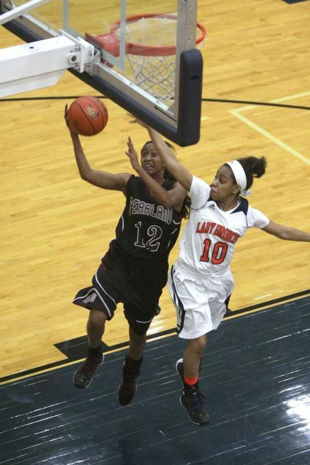 Pearland's Taylor James drives against Bush's Shana Rogers during theirRegion III-5A Area Playoff game Feb. 14 at Hopson Field House in Missouri City. To view or purchase this photo and others like it, go to HCNPics.com. Photo: Alan Warren/HCN
