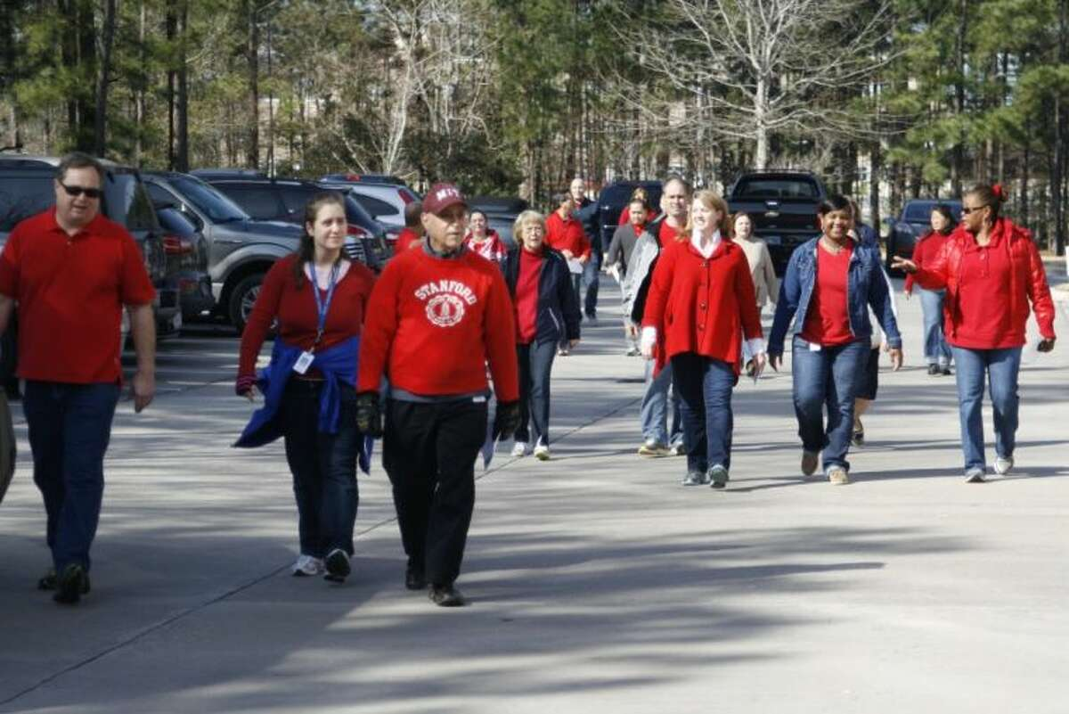 Around 600 Insperity employees had the chance to form a large heart outside of their Kingwood building Feb. 13, 2014 to show their support for the American Heart Association and to raise awareness for heart disease. After the photo opportunity, the employees participated in the annual heart walk around their Kingwood campus.