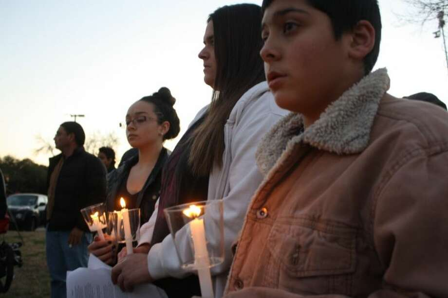 The family of Corrianne Cervantes, including aunt Catera (second from right), and cousins Alejandro and Elana Cervantes, attended comunity prayer vigil Wednesday evening in Clear Lake. Photo: Y.C. OROZCO