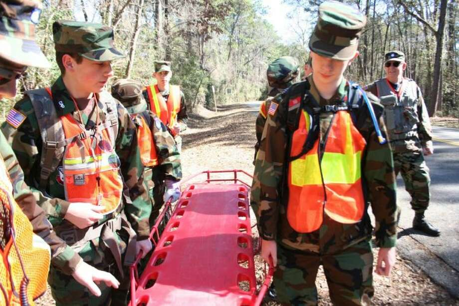 Cadets from Civil Air Patrol's Marauder Composite Squadron, based in Kingwood, operate a litter used to rescue missing victims. Photo: Nate Brown