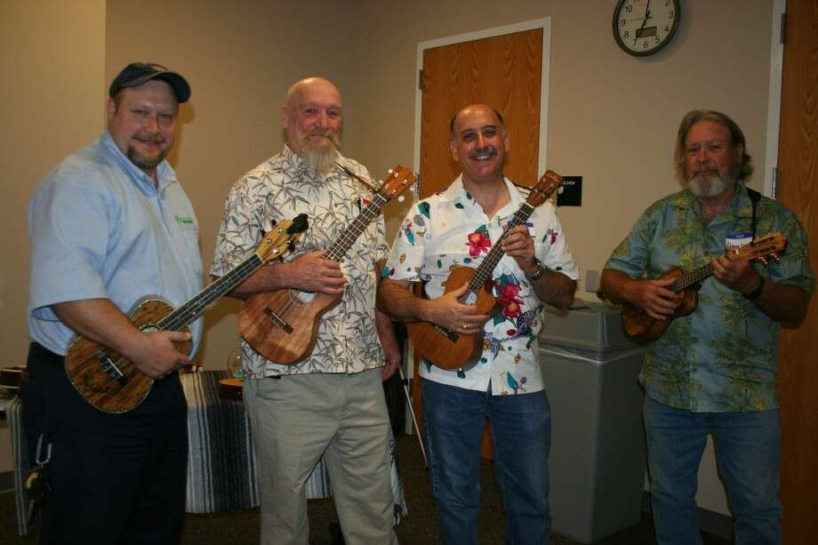 Jon Langley, Buck Stonebroke, Mike Micolosi and David Rogers are among those hosting a series of ukulele classes at R.B. Tullis Branch Library in New Caney. The ukulele program is one of many offered to the public by the venue.