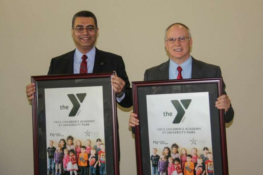 From left, Lone Star College-University Park President Shah Ardalan and President and Chief Operating Officer for Noble Energy, David Stover celebrate the dedication of the YMCA Children's Academy. Photo: Submitted Photo