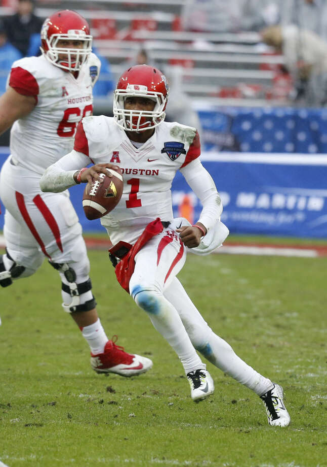Houston quarterback Greg Ward Jr. (1) scrambles with the ball during the second quarter of the Armed Forces Bowl NCAA college football game against Pittsburgh, Friday, Jan. 2, 2015, in Fort Worth, Texas (AP Photo/Sharon Ellman)