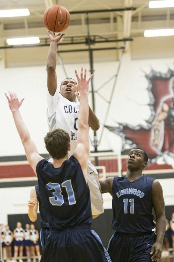 College Park's Kyle Robertson shoots during the Cavaliers' 43-37 bi-district win over Kingwood at Porter High School.
