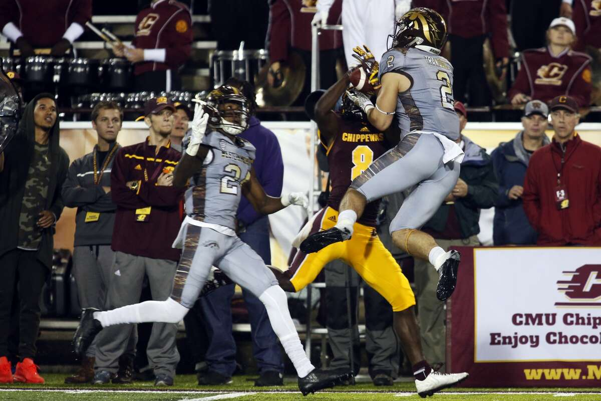 THEOPHIL SYSLO | For the Daily News Central Michigan University wide receiver Corey Willis has the ball intercepted by Western Michigan University Justin Tranquill in a game at the Kelly/Shorts Stadium in Mount Pleasant on Saturday.