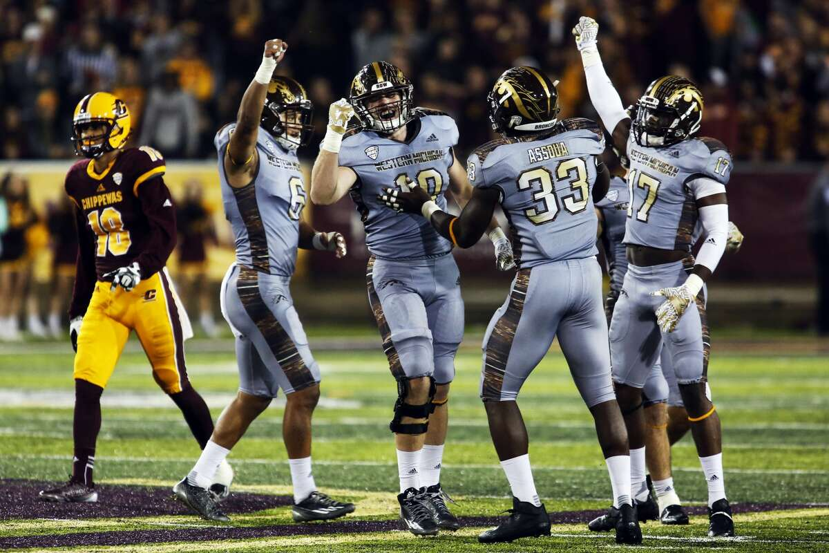 THEOPHIL SYSLO | For the Daily News Western Michigan University defenders celebrate after nearly intercepting the ball on fourth down in a game against Central Michigan University at the Kelly/Shorts Stadium in Mount Pleasant on Saturday.