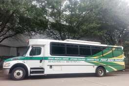 One of the Fort Bend Express Commuter Park and Ride busses idles in front of Greenway Plaza as its driver waits for passengers to board.