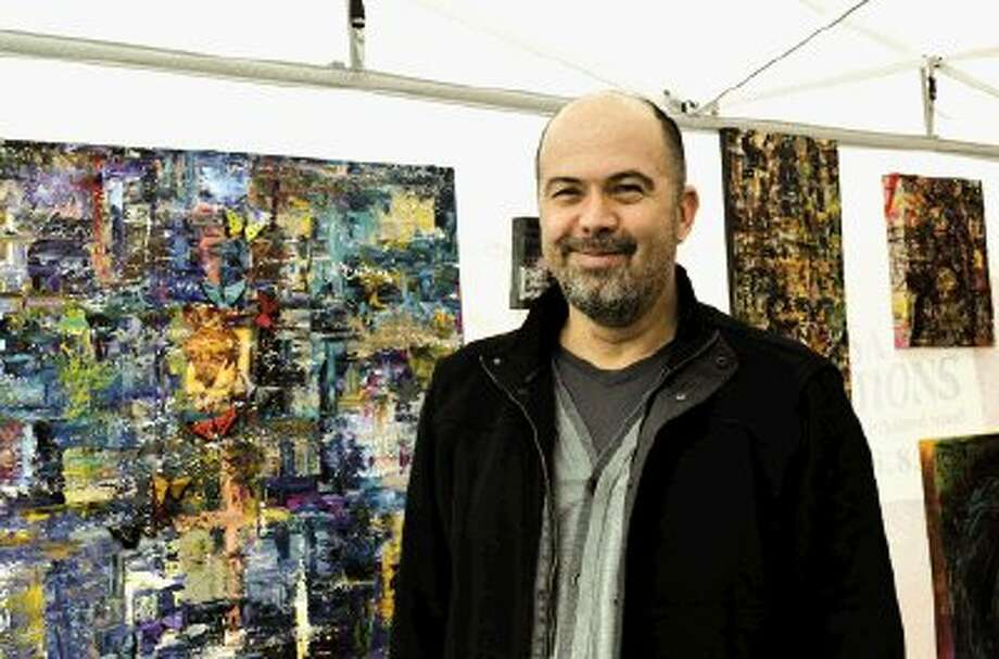 Kingwood resident and First Saturday Arts Market regular Eugene Hughes is an abstract expressionist and paints on canvas. / Dream of Me Photography - Heidi Steinhagen