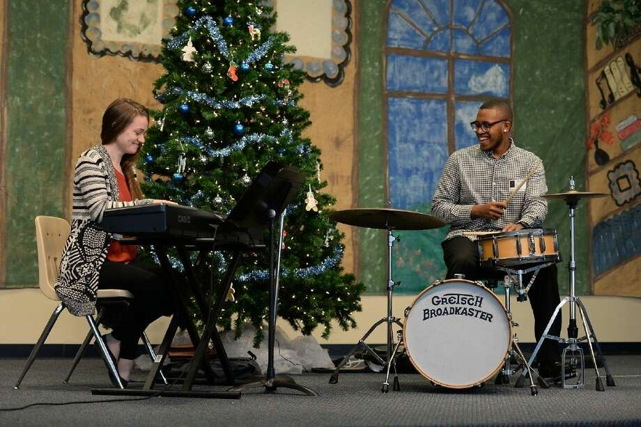 Accompanied by keyboardist Caili O'Dorhety, jazz drummer Cory Cox performs for students at Copeland Elementary School on Dec. 18. Cox's mother, Stephanie Jackson-Joseph, is a Copeland employee.