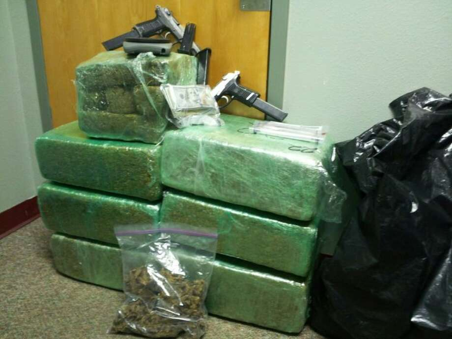 A substantial amount of marijuana - around 171 pounds - reportedly was recovered from a home on CR 3181 in northwest Liberty County. Two people at the home were arrested. Photo: Submitted Photo