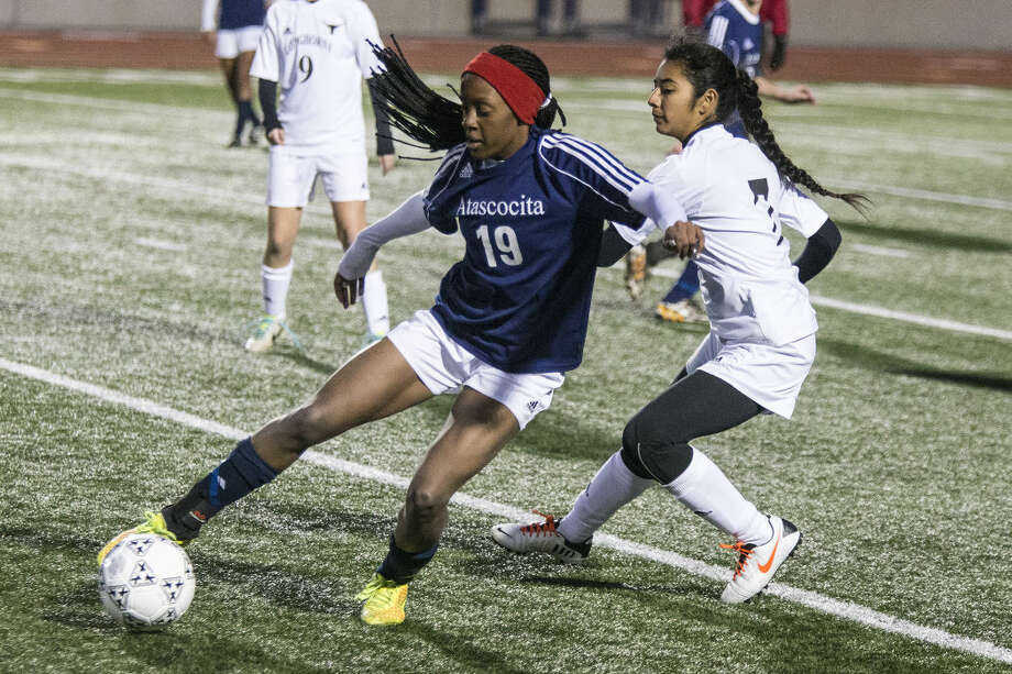 Atascocita's Jazmin Grant (19) attempts to break up the field during the Eagles' 2-0 loss to Dobie in the first round of the HISD Women's Soccer Invitational on Jan. 8, 2014, at Turner Stadium.