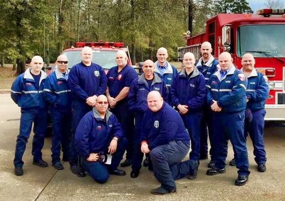 In January, members of the New Caney Fire Department opted to shave their heads in support of Chief Zach Rutledge's wife, who was recently diagnosed with cancer. Now the firefighters are planning a fundraiser for the ailing woman. Photo: Submitted