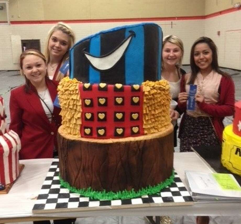 Cleveland High School Culinary Arts students Faith Mikeska, Daryan Canchola, Maria Arias and Nicole Gentz used the theme of Alice in Wonderland for their cake. Photo: Submitted Photo