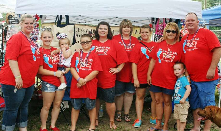 Members of Mikey Pratt's family, along with family friends and supporters, have banded together to keep his memory alive with the Run Safe with Mikey organization. Photo: Stephanie Buckner