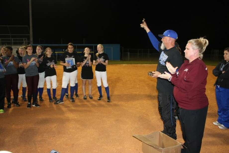 Coaches Mark Meng (left) and Malina Andel (right) present trophies to the Ganado Maidens and the Shepherd Lady Pirates. Photo: JACOB MCADAMS