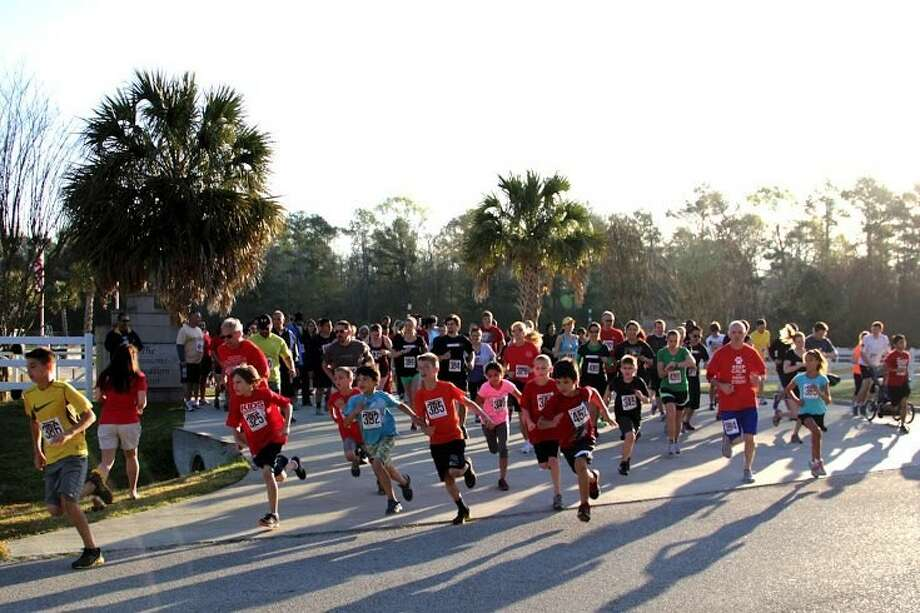 Runners take off at the start of last year's Thurman's 5K in Huffman. This year's run/walk will be held March 1, 2014.