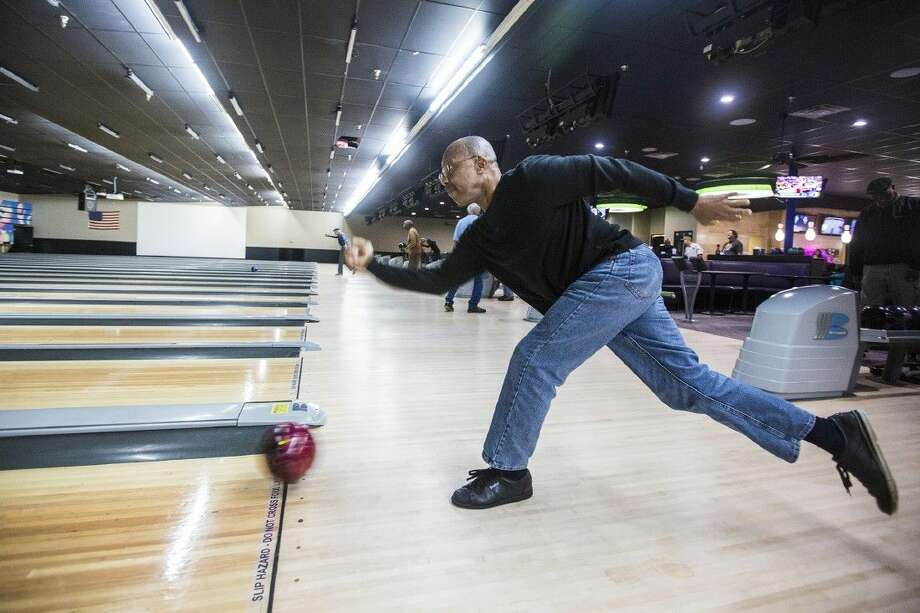 League bowler Robert Jarvis practices with his team Jan. 9, 2014, at Max Bowl North in Humble. The alley wanted to expand their entertainment offerings to the community with their renovations while still maintaining their large bowling league following. Photo: ANDREW BUCKLEY