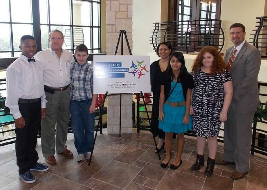 Shown (from left) are: Charles Mabry, Missouri City Mayor Allen Owen, Robert Rose, Independent Studies teacher Kimberley Pleasant, Natalie Macias, Alli Riggs and Quail Valley Middle School Principal Thomas Heinly. Photo: Courtesy FBISD