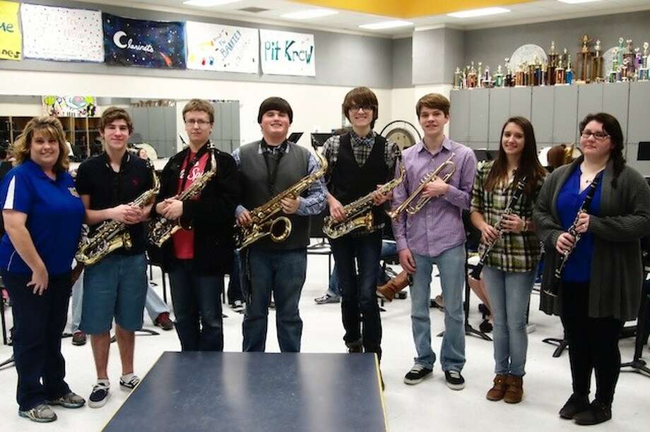 Hardin High School is sending eight band members to state. Shown, from left, are Band Director Gabrielle Chandler, Rayce Risch, Bryce Barrett, Morgan Contreras, Justin Smith, Jakob Luter, Claire Fregia, and Katie Santana. Not shown, but also going to state, is Jessica Rhodes. Photo: CASEY STINNETT / Houston Community Newspapers, 2014