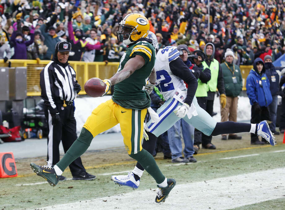 Green Bay Packers wide receiver Davante Adams (17) runs to the end zone for a touchdown against Dallas Cowboys strong safety Barry Church (42) after receiving a pass during the second half of an NFL divisional playoff football game Sunday, Jan. 11, 2015, in Green Bay, Wis. (AP Photo/Matt Ludtke) Photo: Matt Ludtke