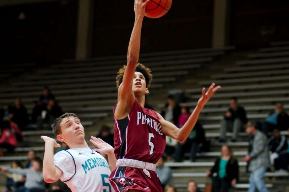 Pearland freshman Ajare Sanni drives to the basket during the Oilers' 68-59 District 22-6A victory over struggling Pasadena Memorial at Phillips Field House Friday night. The Mavs tumble to 1-5 in district, while Pearland, winners of three straight, improve to 4-3. Photo: Kirk Sides