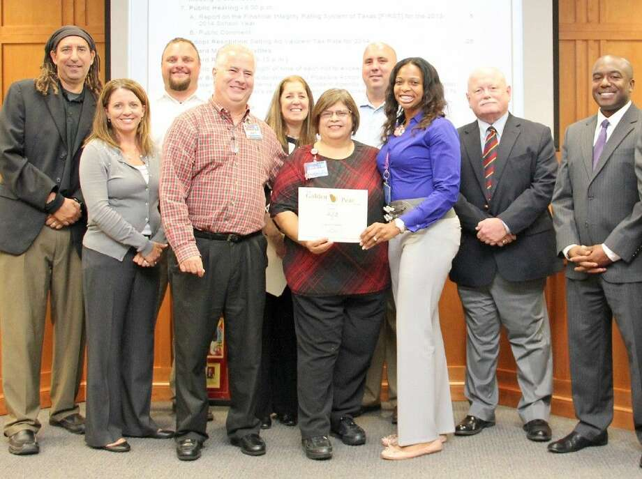 The Pearland ISD Board of Trustees recognizes community partner H-E-B at a fall board meeting.