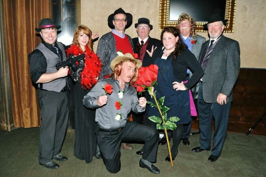 """The audience performers in the Pasadena Historical Society's outrageously funny play """"Rose Garden Murder Mystery"""" take time out for a photo op. Pictured from left, standing are Ron Mo, Director, Kaylei Wharton as """"Rosie"""", Brad Williamson as """"Tony Bologna"""", Jimmy O'Quinn as """"Phillip D. Glass"""", Amy Hance as """"Ivonna Tip"""", Michael Gelbert as"""" James Blond"""", Terry Arnold as """"Frankie"""". Kneeling in front is Don Willis who played the part of """"Petee the Gardner"""". Photo: JACKIE WELCH"""