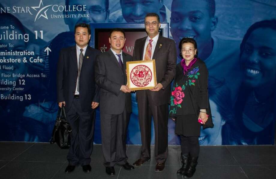 From left, Sun Runlai, Deputy Director of Chinese Confucius Foundation Traditional Culture Education Department; Yang Guang, Director of Chinese Confucius Institute, Beijing; Shah Ardalan, President, LSC-University Park; Xu Guojing, Chinese Confucius Foundation Ambassador of Culture. Photo: Submitted Photo