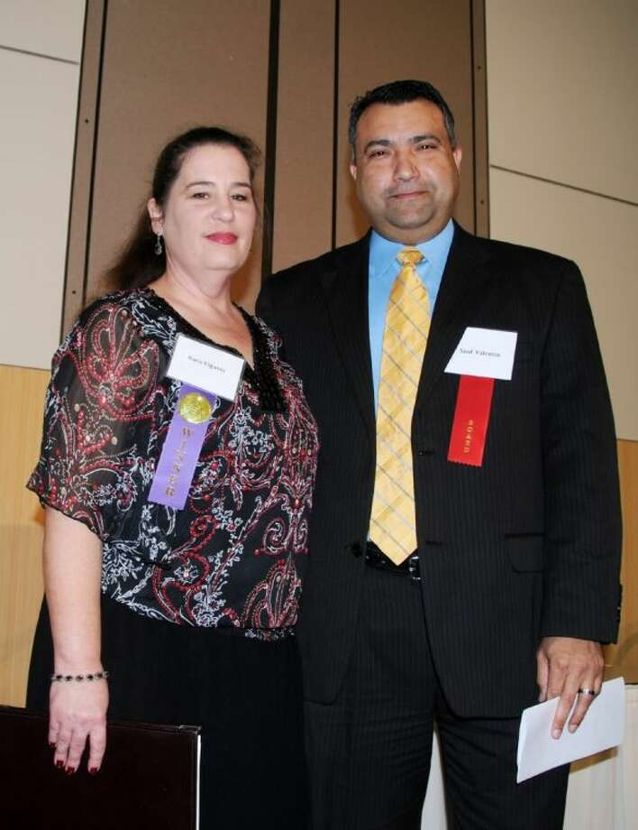 From left, Kara Vigants, Lone Star College-University Park winner of 2014 Student Essay Challenge, with Saul Valentin, Lone Star College Foundation board member. Photo: Submitted Photo