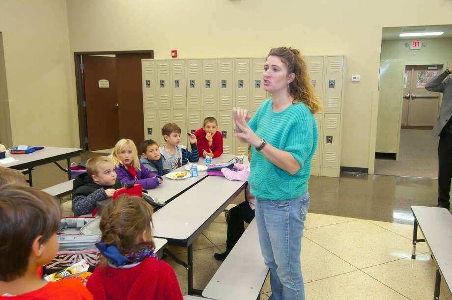 Nichole Friedel instructs elementary students during lunch at Rosehill Christian School. Photo: Tony Gaines
