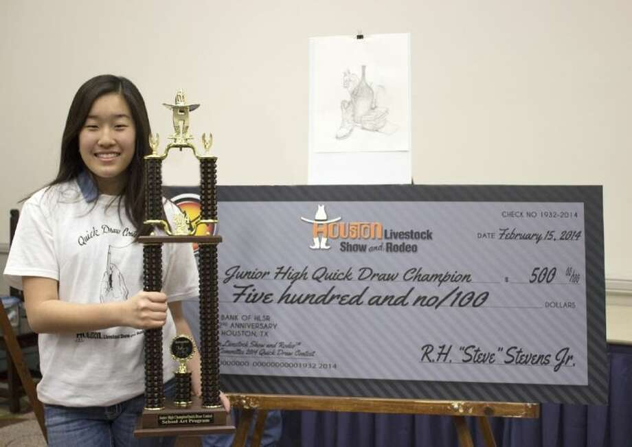 Smith Middle School eighth-grade student Kara Lee displays the trophy and $500 check she received for winning the Houston Livestock Show and Rodeo 2014 Quick Draw Contest on Feb. 15. Photo: Submitted Photo