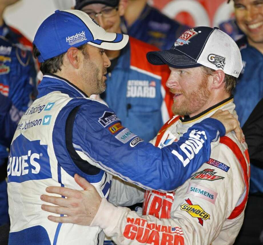 Dale Earnhardt Jr., right, celebrates in Victory Lane with teammate Jimmie Johnsonafter winning the Daytona 500.