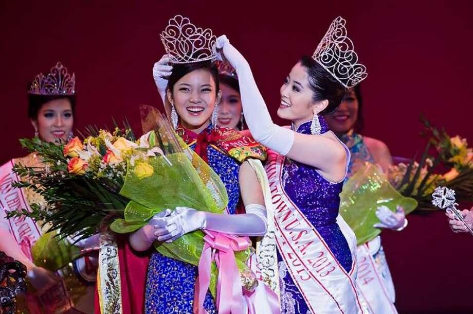 Miss Chinatown USA 2013, Leah Li of Mercer Island, Wash. (right), crowns Cypress Falls High School senior Karen Li as Miss Chinatown USA 2014 during the Feb. 8 Miss Chinatown USA Pageant in San Francisco.