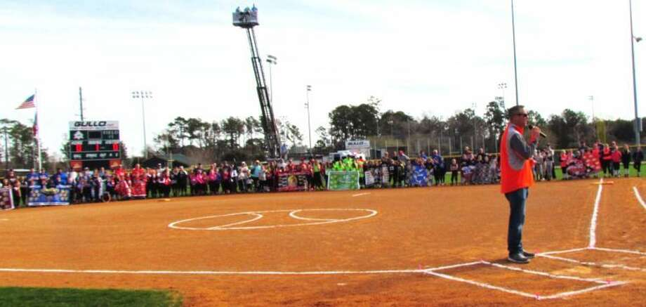 Reid Ryan speaks to the SMGSL softball teams prior to throwing out the first pitch at the softball league's opening day. Photo: Courtesy Photo