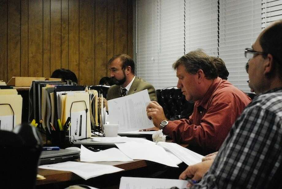 Liberty ISD School Board held a special meeting Monday night, Feb. 24, to consider a petition from residents of Featherstone wanting to be annexed into the district. Shown are Superintendent Cody Abshier, Board Vice-President Matt Harris, and Board member Lloyd Pierce. Photo: CASEY STINNETT / Houston Community Newspapers, 2014