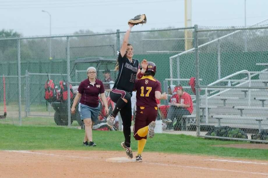 Pearland's Sydney Gutierrez (10) stretches high to make the catch for the out as Deer Park's Alana Tinker (17) runs to first base Thursday in the Haynie Spirit Strike Out Cancer Tournament. Photo: KIRK SIDES