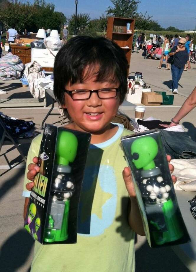 Young Ethan Wong shows off a favorite purchase from a past garage sale in Riverstone. More than 50 families are expected to participate in the community next semi-annual garage sale, set for 8-11 a.m. Saturday, March 8, at the Creekstone Village Recreation Center, 5438 Creekstone Village Dr. in Sugar Land. Photo: Submitted Photo