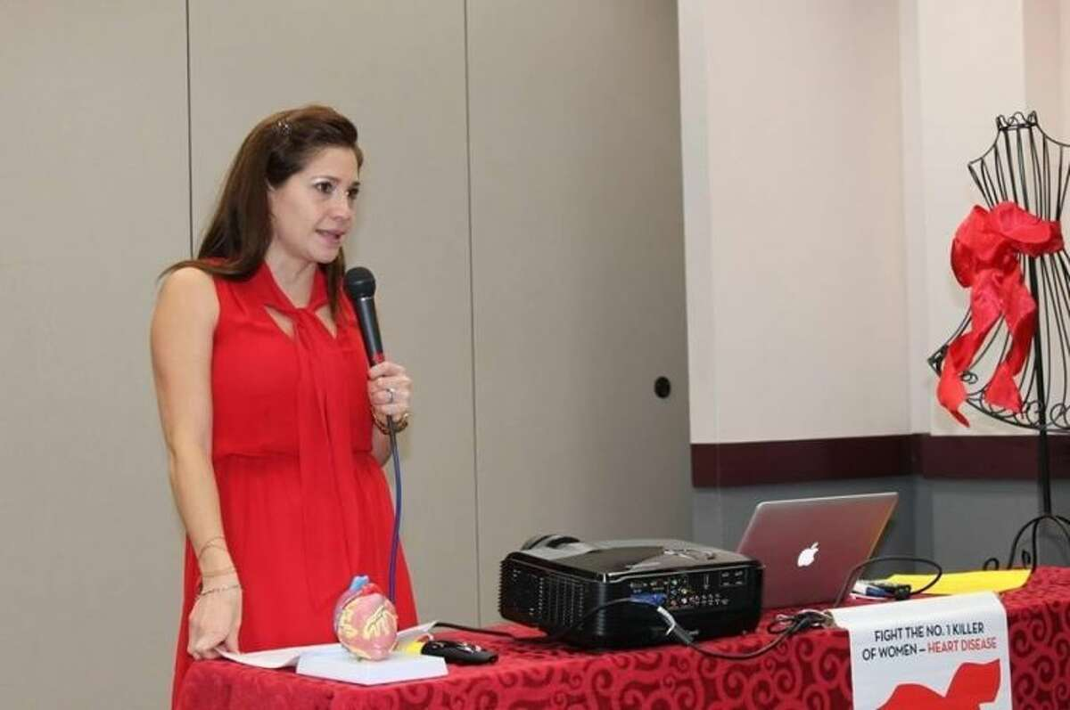 Jeanette Cantu tells her story of survival to attendees of Go Red For Women event.